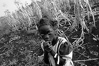 Empowering Victims of War- The daughter of a resident family. Canaan Family Farm lends land to displaced people from the Northern conflict to have them learn the benefits of work and empowerment. Rwakayata, Masindi, Uganda, Africa. December 2005 © Stephen Blake Farrington