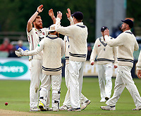 Ivan Thomas (L) of Kent is mobbed after bowling Asad Shafiq during day 1 of the four day tour match between Kent CCC and Pakistan at the St Lawrence Ground, Canterbury, on Sat April 28, 2018