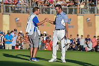Corey Conners (CAN) shakes hands with his caddie after winning the Valero Texas Open, at the TPC San Antonio Oaks Course, San Antonio, Texas, USA. 4/7/2019.<br /> Picture: Golffile | Ken Murray<br /> <br /> <br /> All photo usage must carry mandatory copyright credit (© Golffile | Ken Murray)