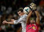 Real Madrid's Welsh striker Gareth Bale vies with Almeria's goalkeeper Esteban Andres Suarez during the Spanish league football match Real Madrid Madrid vs U.D Almeria at the Santiago Bernabeu stadium in Madrid on April 12, 2014  PHOTOCALL3000 / DP