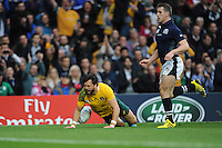 Adam Ashley-Cooper of Australia dives over to score the opening try during the Quarter Final of the Rugby World Cup 2015 between Australia and Scotland - 18/10/2015 - Twickenham Stadium, London<br /> Mandatory Credit: Rob Munro/Stewart Communications