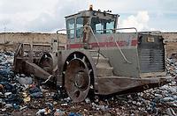 Bulldozer burying waste at the landfill site..©shoutpictures.com..john@shoutpictures.com