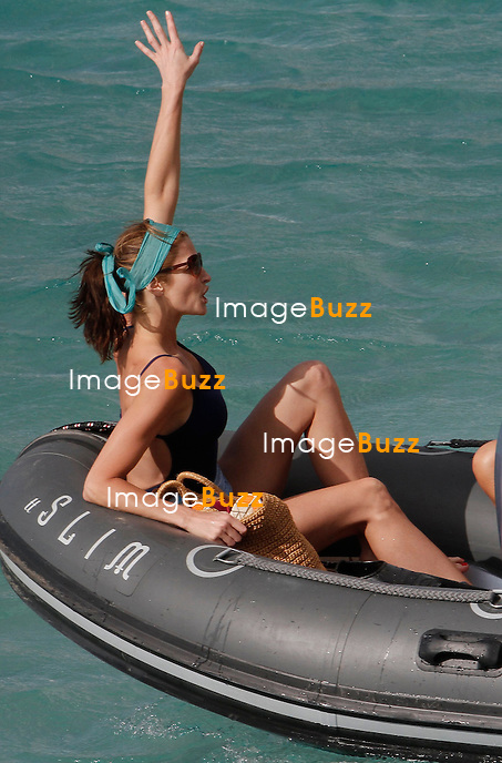 STEPHANIE SEYMOUR IN ST. BARTHS - December 28,2012-St Barths (FR)-Supermodel Stephanie Seymour with child Peter, Harry and Lily and a male friend enjoying a picnic on the beach in St.Bart's.  .The gorgeous former Sports Illustrated cover girl, 44, showed off her incredible figure during her annual holiday trip to the island..Seymour was spotted wearing a sexy one-piece swimsuit at the beach on the Caribbean island as she vacationed with her three kids ;  Peter  Harry and and Lily Margaret.