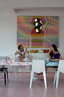 Karim Rashid and his wife Ivana sitting at the dining table
