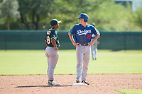 Los Angeles Dodgers catcher Hunter Feduccia (76) and Oakland Athletics second baseman Cobie Vance (19) share a laugh during an Instructional League at Camelback Ranch on October 4, 2018 in Glendale, Arizona. (Zachary Lucy/Four Seam Images)