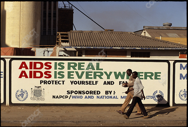 Government sponsored AIDS prevention billboards on the property of the National Milling Company, Cairo Road, Lusaka, Zambia, July 1993