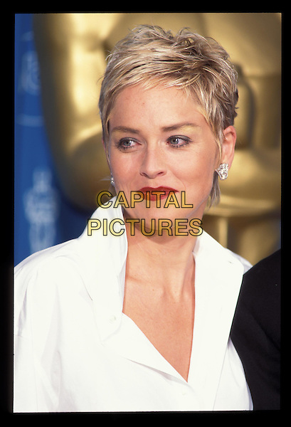 SHARON STONE.Ref: 7237.diamond earrings, red lipstick, headshot, portrait.RAW SCAN - PHOTO WILL BE ADJUSTED FOR PUBLICATION.www.capitalpictures.com.sales@capitalpictures.com.©Capital Pictures.