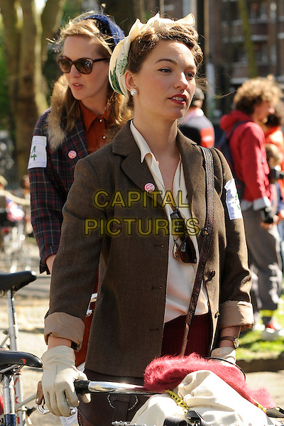 London, England on April 18, 2015. 7th Annual Tweed ten-mile bicycle ride aimed at revisiting the fashions and pastimes of the polite aspects of 1920's to 1950's England<br /> CAP/IA<br /> &copy;Ian Allis/Capital Pictures