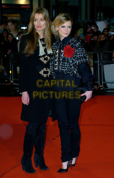 "NATASHA McELHONE & EMILIA FOX.""Becoming Jane"" World Premiere, Odeon West End, .London, England, March 4th 2007..full length black coat cape red flower corsage.CAP/CAN.©Can Nguyen/Capital Pictures"