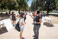 Career Services staff Claudia Biezonsky<br /> 2018 InternLA student participants share their poster presentations about their summer experiences working as interns in Los Angeles. Summer Experience Expo, Sept. 13, 2018 in the Academic Quad. Hosted by Career Services.<br /> (Photo by Marc Campos, Occidental College Photographer)