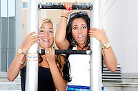 Jackie and Olivia from the hit reality show Jerseylicious pictured taking a trapeze lesson from  I.Fly Trapeze school on the large patio deck between the Chairman Tower and the Taj Tower, at Trump Taj Mahal in Atlantic City, New Jersey on July 6, 2012  © Star Shooter / MediaPunchInc