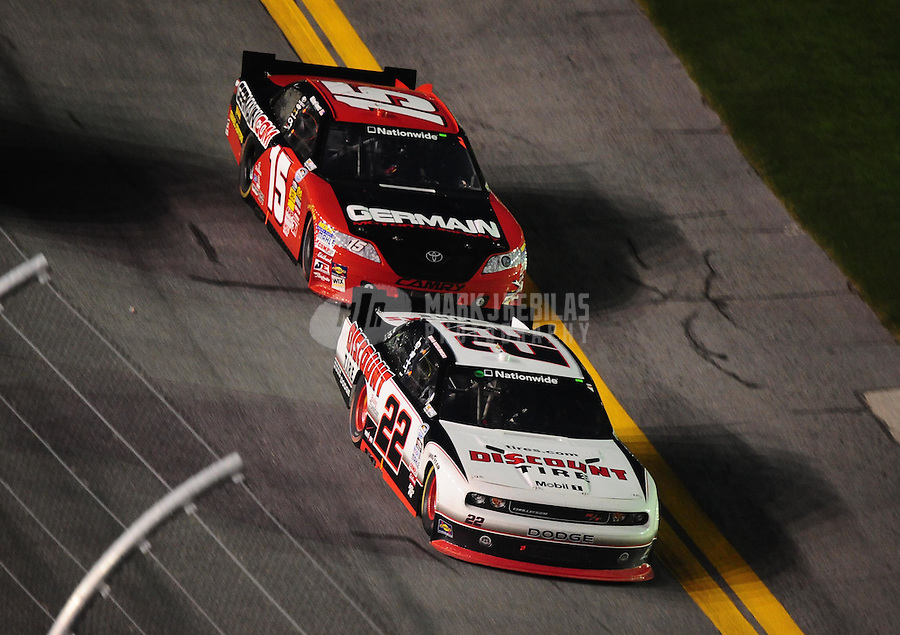 Jul. 2, 2010; Daytona Beach, FL, USA; NASCAR Nationwide Series driver Brad Keselowski (22) leads Michael Annett during the Subway Jalapeno 250 at Daytona International Speedway. Mandatory Credit: Mark J. Rebilas-