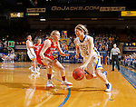 BROOKINGS, SD - JANUARY 17:  Macy Miller #12 from South Dakota State looks to drive against  Madeline Homoly #24 from the University of South Dakota in the first half of their game Sunday afternoon at Frost Arena in Brookings, S.D. (Photo by Dave Eggen/Inertia)