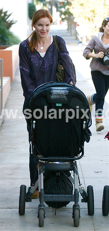 **ALL ROUND PICTURES FROM SOLARPIX.COM**.**WORLDWIDE SYNDICATION RIGHTS EXCEPT FOR USA, AUSTRALIA & GERMANY**.Desperate Housewife actress Marcia Cross was spotted taking her new baby for a stoll in Brentwood, CA. USA..JOB REF:   7900     LAS       DATE:15.11.08.**MUST CREDIT SOLARPIX.COM OR DOUBLE FEE WILL BE CHARGED* *UNDER NO CIRCUMSTANCES IS THIS IMAGE TO BE REPRODUCED FOR ANY ONLINE EDITION WITHOUT PRIOR PERMISSION*