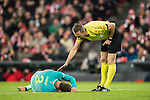Referee David Fernandez Borbalan checks on Gerard Pique Bernabeu of FC Barcelona who lies injured on the pitch during their Copa del Rey Round of 16 first leg match between Athletic Club and FC Barcelona at San Mames Stadium on 05 January 2017 in Bilbao, Spain. Photo by Victor Fraile / Power Sport Images