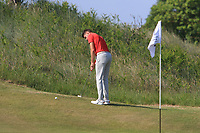 Devin Morley (Oughterard) on the 16th green during Round 4 of the East of Ireland Amateur Open Championship 2018 at Co. Louth Golf Club, Baltray, Co. Louth on Monday 4th June 2018.<br /> Picture:  Thos Caffrey / Golffile<br /> <br /> All photo usage must carry mandatory copyright credit (&copy; Golffile | Thos Caffrey)