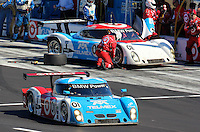 30 January 2011: The winning Ganassi Racing BMW Riley of Scott Pruett, Memo Rojas, Graham Rahal and Joey Hand leaves the pits as its team car recieves service,   Rolex 24 at Daytona, Daytona International Speedway, Daytona Beach, FL (Photo by Brian Cleary/www.bcpix.com)