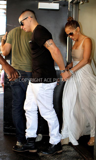 WWW.ACEPIXS.COM . . . . .  ....July 24 2012, New York City....Jennifer Lopez and Casper Smart leave Bubby's restaurant on July 24 2012 in New york City....Please byline: NANCY RIVERA- ACEPIXS.COM.... *** ***..Ace Pictures, Inc:  ..Tel: 646 769 0430..e-mail: info@acepixs.com..web: http://www.acepixs.com