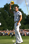 7 September 2008:   Camilo Villegas tips his cap to the spectators gathered at the 18th hole after winning the BMW Golf Championship at Bellerive Country Club in Town & Country, Missouri, a suburb of St. Louis, Missouri on Sunday September 7, 2008. The BMW Championship is the third event of the PGA's  Fed Ex Cup Tour.