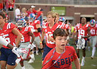 NWA Democrat-Gazette/CHARLIE KAIJO Ole Miss players storm the field before a football game, Saturday, September 7, 2019 at Vaught-Hemingway Stadium in Oxford, Miss.