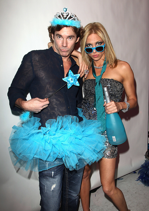 ** EXCLUSIVE ** Dr. Rutledge Tayor and Debbie Gibson poses for pictures at Perez Hilton's Blue Ball birthday celebration Saturday March 26, 2011, in the Hollywood section of Los Angeles. (Donald Traill/AP Images)