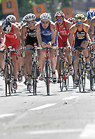 03 SEP 2006 - LAUSANNE, SWITZERLAND - A pack climbs a hill during the 2006 Elite Mens World Triathlon Championships. (PHOTO (C) NIGEL FARROW)