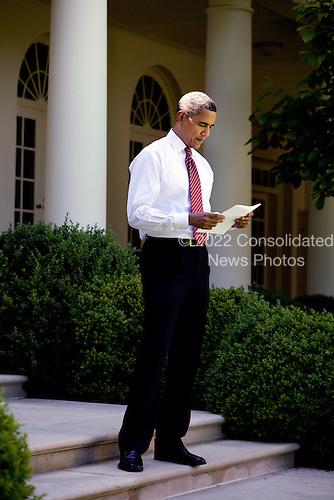 Washington, DC - May 20, 2009 -- United States President Barack Obama reads a document outside the Oval Office on the steps leading into the Rose Garden, May 20, 2009..Mandatory Credit: Pete Souza - White House via CNP