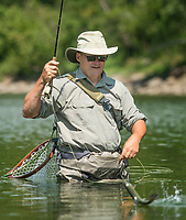 NWA Democrat-Gazette/BEN GOFF @NWABENGOFF<br /> Greg Darling of Carbondale, Ill. brings in a rainbow trout Friday, Aug. 3, 2018, while fishing in the White River below Beaver Dam.