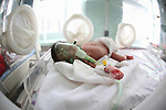 Newborn in an incubator with breathing apparatus in a hospital in Kabul, Afghanistan