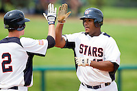 Nelson Rodriguez #15 of STARS high fives teammate Chris Harvey #12 after hitting a home run against RBIat the 2011 Tournament of Stars at the USA Baseball National Training Center on June 26, 2011 in Cary, North Carolina. (Brian Westerholt/Four Seam Images)