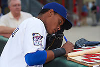 Chattanooga Lookouts shortstop Jorge Polanco (11) signs autographs before a game against the Jacksonville Suns on April 30, 2015 at AT&T Field in Chattanooga, Tennessee.  Jacksonville defeated Chattanooga 6-4.  (Mike Janes/Four Seam Images)