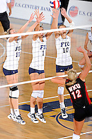 16 October 2010:  FIU right side hitter Ines Medved (11), middle blocker Andrea Lakovic (1) and outside hitter Marija Prsa (10) attempt to block a shot in the third set as the Western Kentucky Hilltoppers defeated the FIU Golden Panthers, 3-2 (25-19, 23-25, 25-20, 25-27, 15-13), at the U.S Century Bank Arena in Miami, Florida.