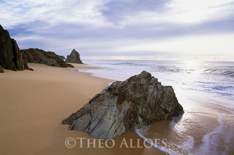 Australia, NSW, Mimosa Rocks National Park, rocky outcrops on sandy beach
