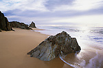 Australia, NSW, Mimosa Rocks National Park, rocky outcrops on sandy beach