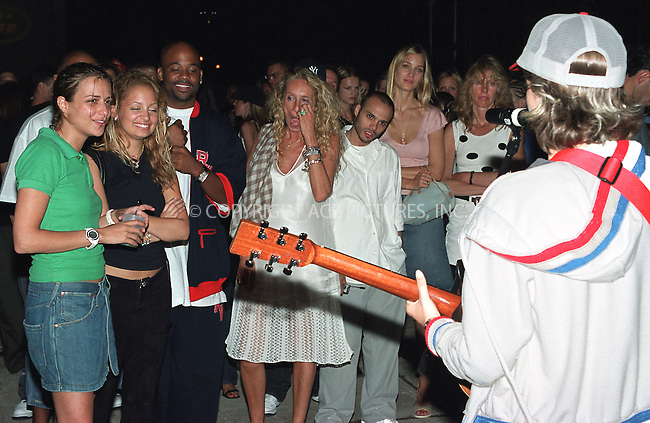 2003 Land Rover launch party in New York, June 26, 2002. Pictured socialites watch DJ Samantha Ronson perform. Please byline: Alecsey Boldeskul/NY Photo Press.   ..*PAY-PER-USE*      ....NY Photo Press:  ..phone (646) 267-6913;   ..e-mail: info@nyphotopress.com