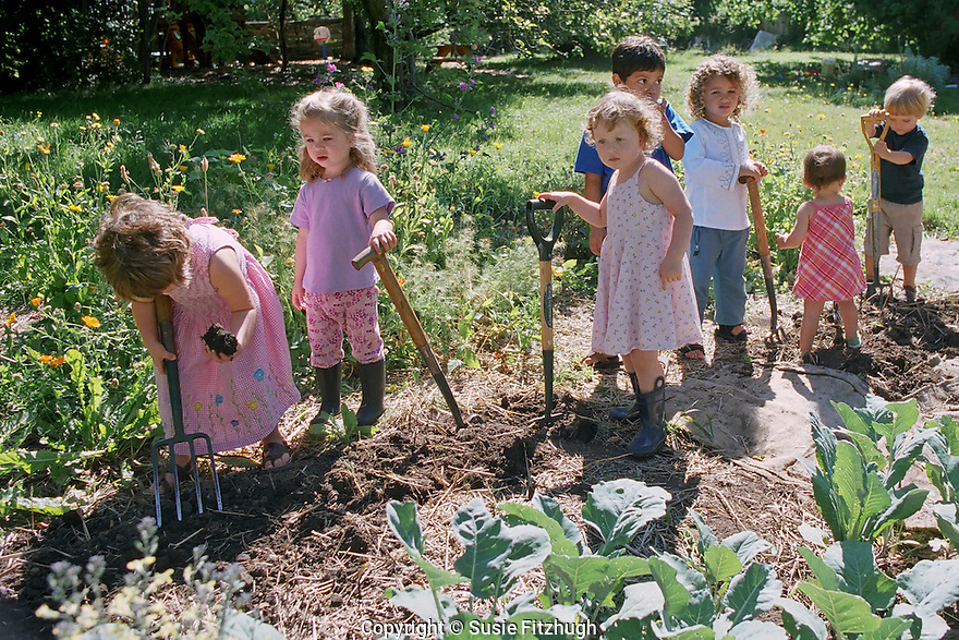 At a small Spanish-language preschool in Seattle, the children spend a warm Spring day outside, making a garden.