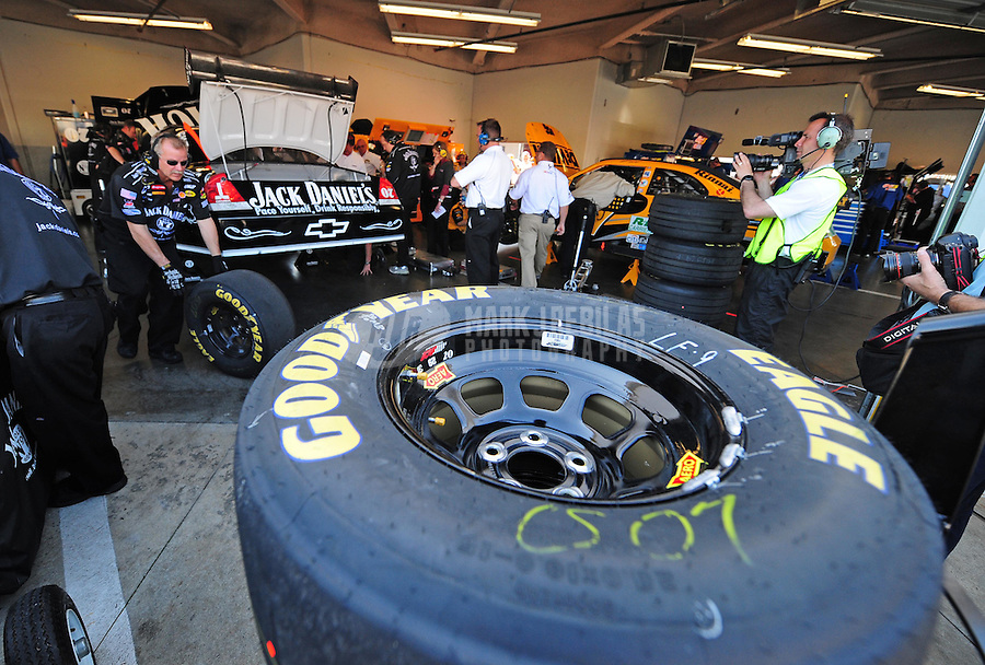 Feb 16, 2008; Daytona Beach, FL, USA; A stack of Goodyear Tires sits behind the car of Nascar Sprint Cup Series driver Clint Bowyer during practice for the Daytona 500 at Daytona International Speedway. Mandatory Credit: Mark J. Rebilas-US PRESSWIRE