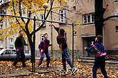 Sofia, Bulgaria. Boys playing voleyball; lots of leaves on the ground.