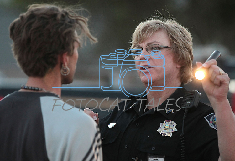 Nevada Highway Patrol Sgt. Jamie Jorgensen conducts a field sobriety test during a DUI checkpoint in Carson City, Nev. on Sunday, Sept. 2, 2012. Several area agencies participated including Carson City Sheriff's Department, Nevada Highway Patrol and Lyon County Sheriff..Photo by Cathleen Allison