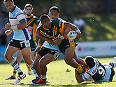 Ronnie Alovili of the Wyong Roos is tackled by Junior Moors and Pat Politoni of the Cronulla Sharks during Round 5 of the 2013 NSW Cup at Morrie Breen Oval on April 7, 2013 in Wyong, Australia. (Photo by Paul Barkley/LookPro)