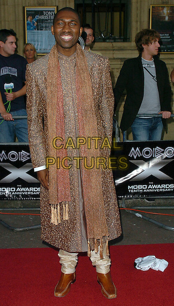 KWAME KWEI ARMAH.MOBO Awards 2005 at the Royal Albert Hall, London..September 22nd, 2005.www.capitalpictures.com.full length scarf brown jacket.sales@capitalpictures.com.©Capital Pictures