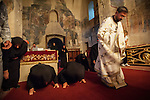 Worship during the Exaltation (Elevation) of the Holy Cross liturgy service, inside the Church of the Ascension of Jesus Christ at the Monastery Mileševa, Serbia originally built in the 12th century.