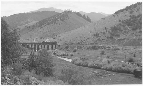 D&amp;RGW #496 with northbound gondolas crossing the Mears Junction trestle.<br /> D&amp;RGW  Mears Junction, CO  Taken by Lunoe, Bob - 7/1945