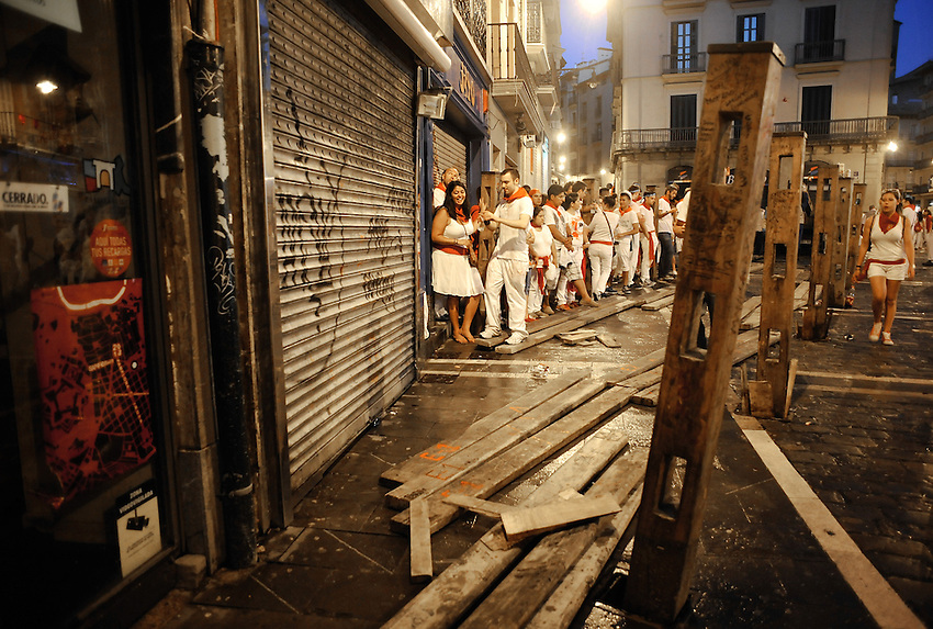 People wait the beginning of the third running of the bulls of San Fermin Festival since two hours before, on July 9, 2013, in Pamplona, Basque Country. On each day of the eight San Fermin festival days six bulls are released at 8:00 a.m. (0600 GMT) to run from their corral through the narrow, cobbled streets of the old navarre town over an 850-meter (yard) course. Ahead of them are the runners, who try to stay close to the bulls without falling over or being gored. (Ander Gillenea / Bostok Photo)