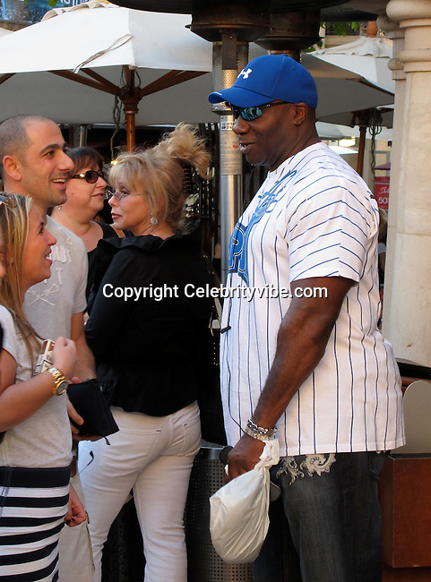 **EXCLUSIVE**.Michael Clark Duncan..Michael Clark Duncan shopping at The Grove and then getting a table by himself at a Restaurant..The Grove Shopping Mall..West Hollywood, CA, USA..Monday, February 15, 2010..Photo By Celebrityvibe.com.To license this image please call (212) 410 5354; or Email: celebrityvibe@gmail.com ; .website: www.celebrityvibe.com.