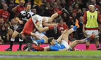 Wales James Davies tumbles over the ruck<br /> <br /> Photographer Ian Cook/CameraSport<br /> <br /> 2018 NatWest Six Nations Championship - Wales v Italy - Sunday 11th March 2018 - Principality Stadium - Cardiff<br /> <br /> World Copyright &copy; 2018 CameraSport. All rights reserved. 43 Linden Ave. Countesthorpe. Leicester. England. LE8 5PG - Tel: +44 (0) 116 277 4147 - admin@camerasport.com - www.camerasport.com