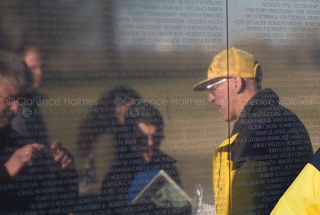 A veteran talks to visitors at the Vietnam Veterans Memorial.