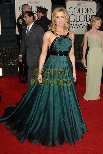 FELICITY HUFFMAN.Red Carpet Arrivals - 64th Annual Golden Globe Awards, Beverly Hills HIlton, Beverly Hills, California, USA, January 15th 2007.globes full length green dress gown black belt .CAP/PL.©Phil Loftus/Capital Pictures