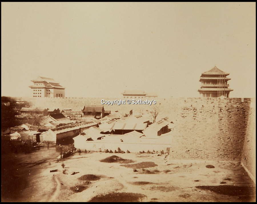 BNPS.co.uk (01202 558833)<br /> Pic: Sotheby's/BNPS<br /> <br /> City walls and towers, Beijing.<br /> <br /> A collection of rare early photographs capturing day-to-day life in China 150 years ago are set to sell for £80,000. <br /> <br /> The stunning album, comprising 41 black and white images of Beijing, depicts an array of busy street scenes and portraits of inhabitants from all walks of life. <br /> <br /> The pictures show chess players deep in concentration, musicians entertaining on the side of the road as well as striking images of the city's historically important architecture.