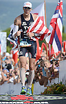 KAILUA-KONA, HI - OCTOBER 13:  Andy Potts of the USA crosses the finish line in 6th place during the 2012 IRONMAN World Championships on October 13, 2012 in Kailua-Kona, Hawaii. (Photo by Donald Miralle)